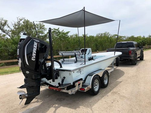 boat with boat shade attached to pickup truck