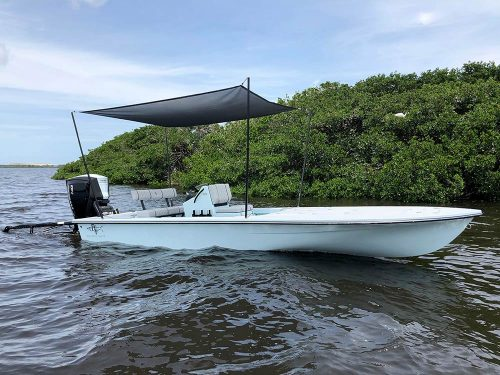 Sideview of boat and boat shade on florida bay water.
